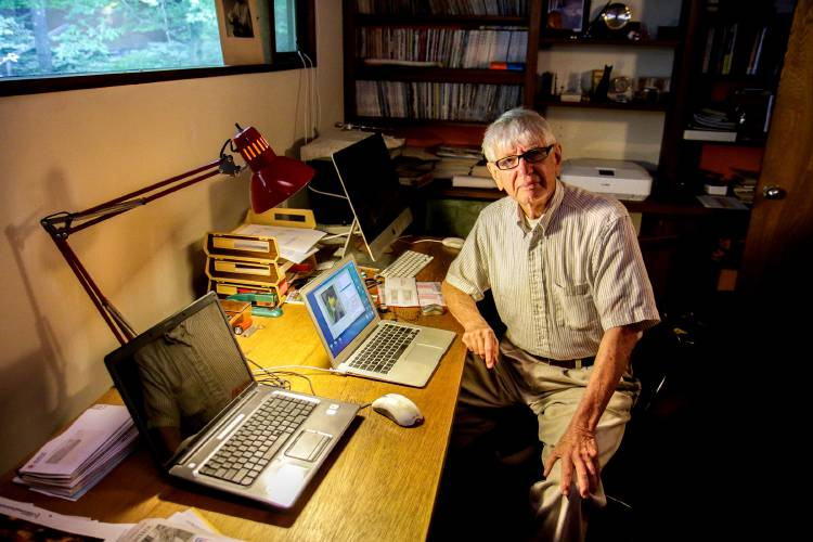 Tom Kurtz sits in his computer room in his home in Hanover, N.H., on Thursday, Aug. 9, 2018. Kurtz is one of two people that created the BASIC computer language and launched one of the first long-distance computer networks, the Dartmouth time-sharing system. (Valley News - August Frank) Copyright Valley News. May not be reprinted or used online without permission. Send requests to permission@vnews.com.