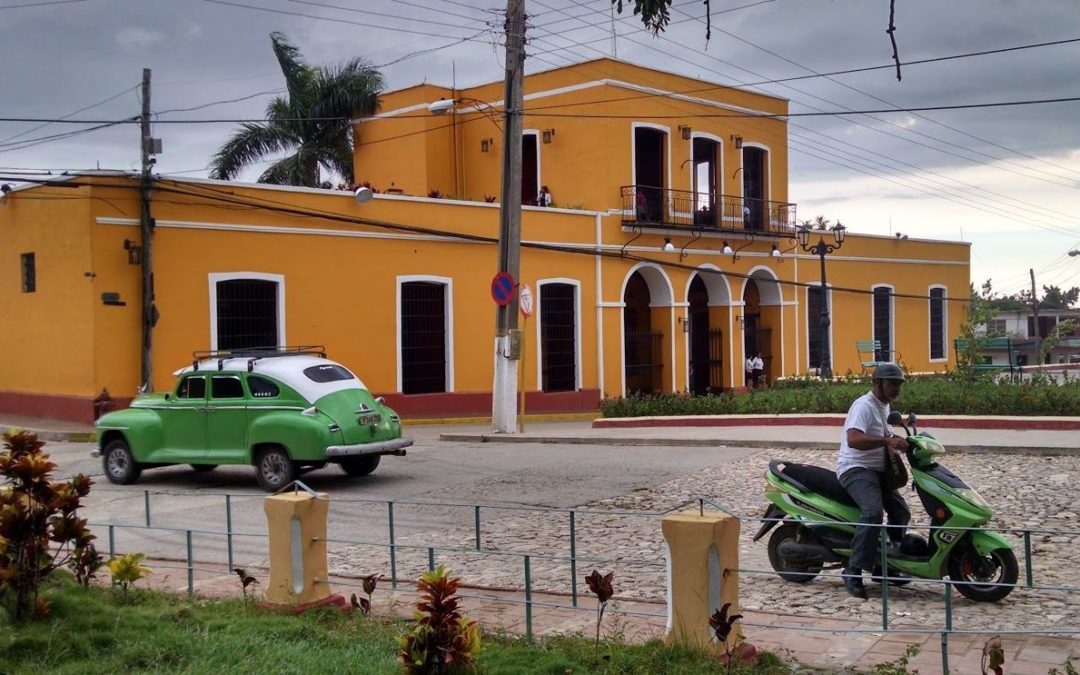 In Cuba, those old American cars share the road with Chinese electric motorcycles