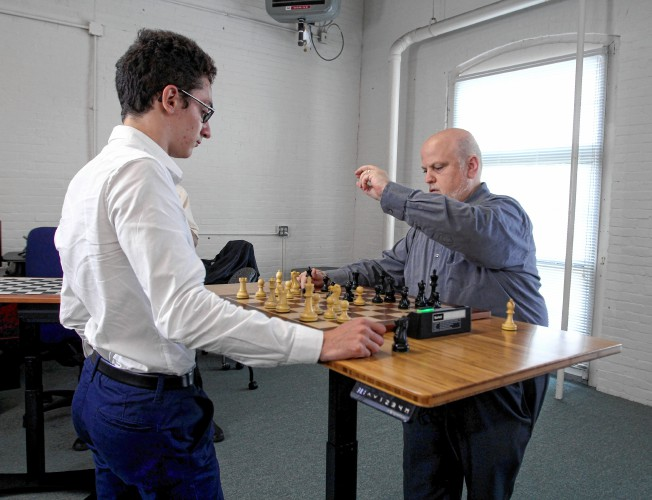 A (tiny) NH connection for the guy trying to win the world chess championship