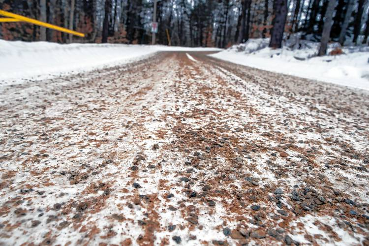 The small stones embed into the snow and dirt on the access road to the Epsom town garage. (Geoff Forester/Monitor staff)