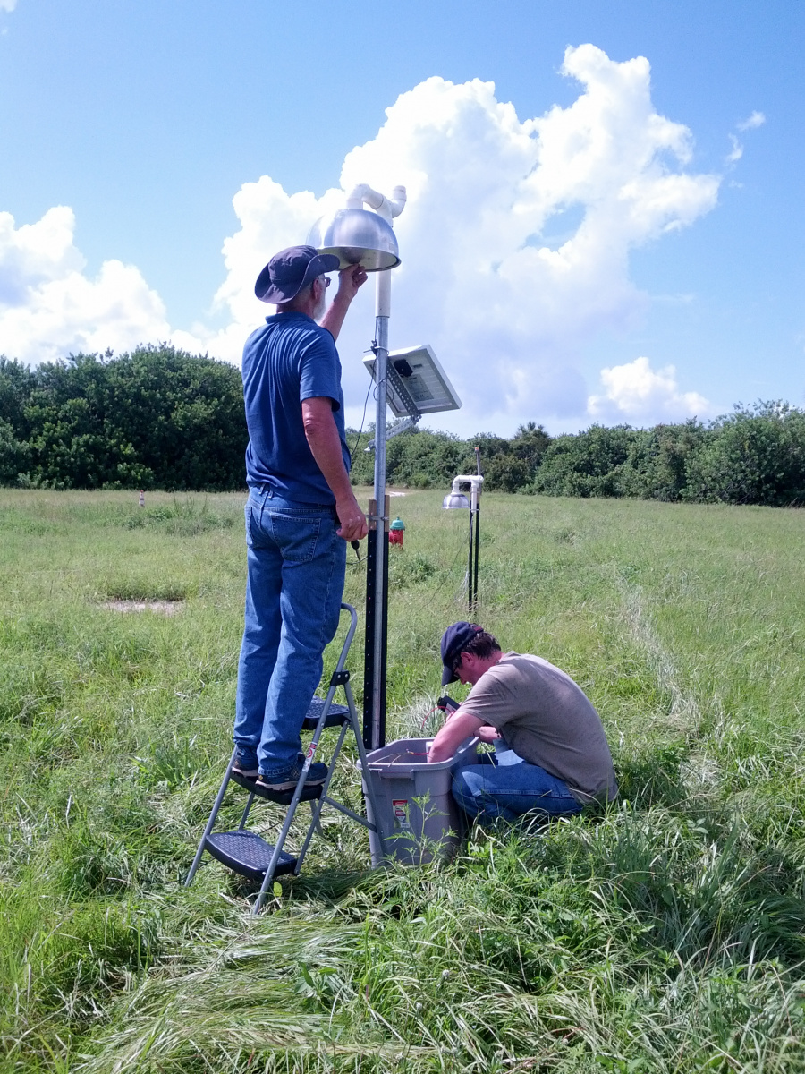 Researchers install electric field sensors in ground-based antennas that help determine the current direction that triggers lightning in the clouds. Credit: Julia Tilles