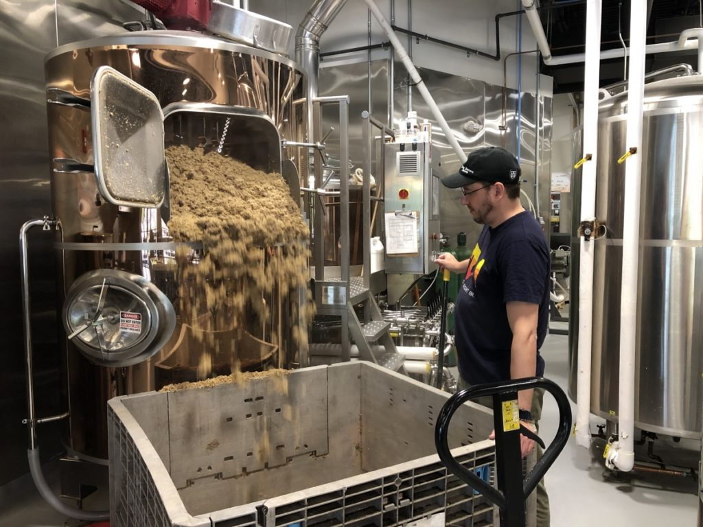 Bad Lab Beer Co. of Somersworth provided wet brewers grains for the study. Here Matt Palmer, assistant brewer, works with a batch of wet brewers grains. Credit: Bad Lab Beer Co.